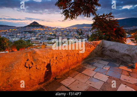 View of Athens dominated by Lycabettus hill. Image taken from Anafiotika in the old Town. - Stock Photo