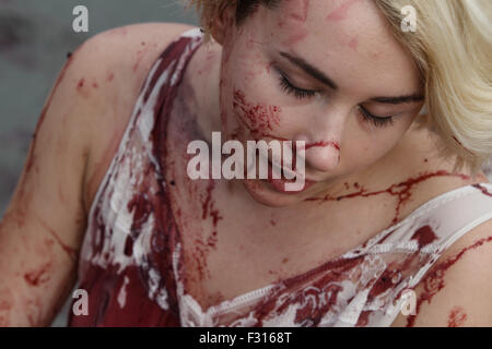 Kiev, Ukraine. 27th Sep, 2015. A bloodstained face of animal rights activist during the protest. Animal rights activists - Stock Photo
