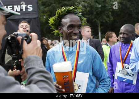 Berlin, Germany. 27th Sep, 2015. Eliud Kipchoge celebrates for his awards during the 42nd Berlin Marathon. Credit: - Stock Photo
