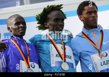 Berlin, Germany. 27th Sep, 2015. Eliud Kipchoge (center) at the award ceremony of the 42nd Berlin Marathon. Credit: - Stock Photo