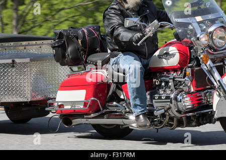 Close up of a red and white Honda Valkyrie towing a trailer. - Stock Photo