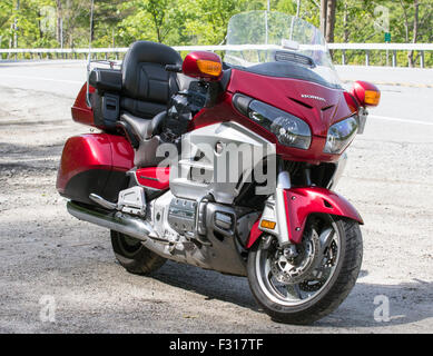 Red Honda Gold Wing motorcycle motorbike parked on the side of the road. - Stock Photo
