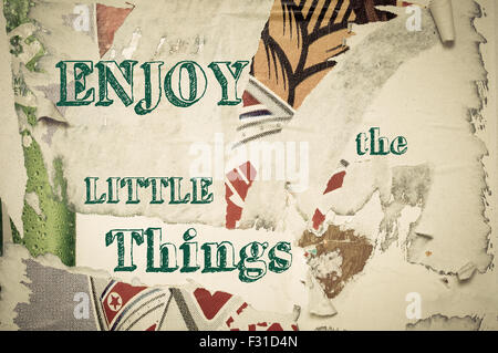 Enjoy the Little Things - Inspirational message written on vintage grunge background with Old Torn Posters. Motivational - Stock Photo