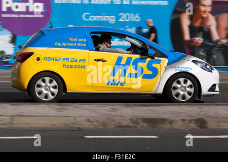 A blurred moving HSS Hire car, tool & Equipment,  at speed motion blur on 'The Strand' at Liverpool One, Liverpool, - Stock Photo
