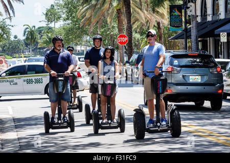 West Palm Beach Florida Arts & Entertainment District Clematis Street Segway riders Segways guide man woman - Stock Photo