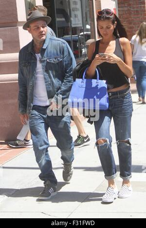 Crazy Town frontman Shifty Shellshock goes shopping in Beverly Hills with a female companion  Featuring: Shifty - Stock Photo