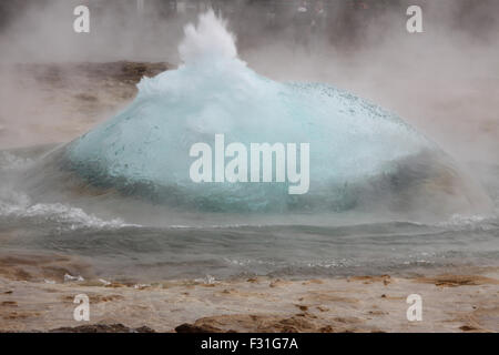 The Great Geysir just about to erupt, Southwestern Iceland. - Stock Photo