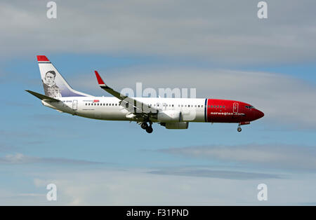 Norwegian Air Shuttle Boeing 737-800 (LN-DYQ) landing at Birmingham Airport, UK - Stock Photo