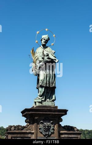 St. John of Nepomuk statue on Charles bridge of Prague, Czech republic - Stock Photo