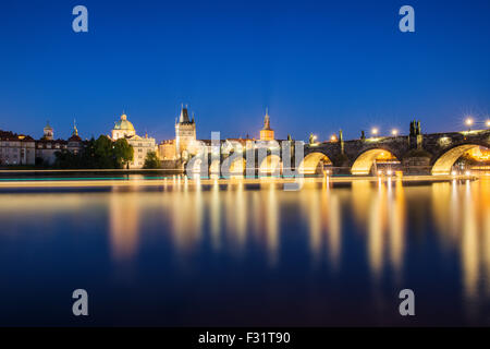 Night view of colorful old town and Charles Bridge with river Vltava, Prague, Czech Republic - Stock Photo