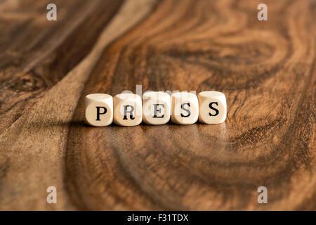 PRESS word background on wood blocks - Stock Photo