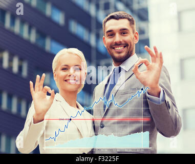 smiling businessmen standing over office building - Stock Photo