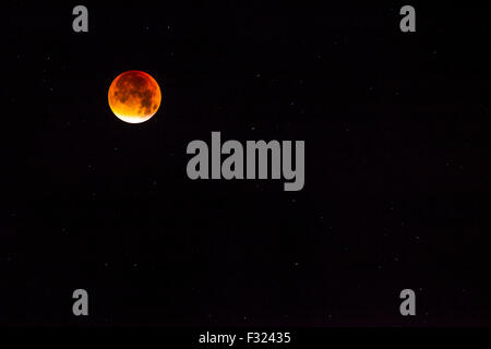 The supermoon Blood Moon over Avebury in Wiltshire, England, UK taken on the 28th September 2015. - Stock Photo