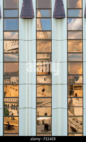Fishermans Bastion reflected in the windows of the Hilton Hotel, castle hill, Budapest, Hungary - Stock Photo