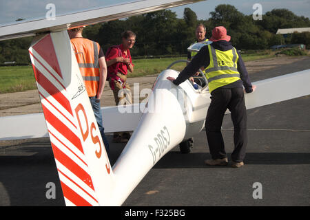 Glider club members and pilot prepare a Grob G103 Twin Astir glider for launch at Shobdon airfield in Herefordshire - Stock Photo