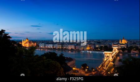 Dusk shot from Royal Palace of Szechenyi chain bridge, River Danube, Budapest, Hungary - Stock Photo