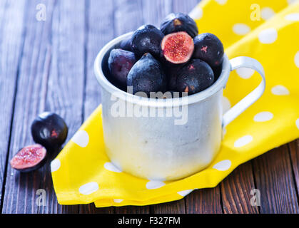 fresh figs in metal cup and on a table - Stock Photo