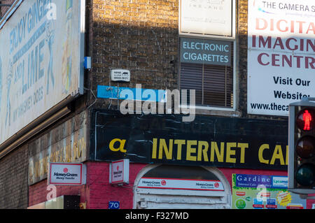 Advertising graphics signs on Gardiner Street Lower in Dublin, Ireland - Stock Photo