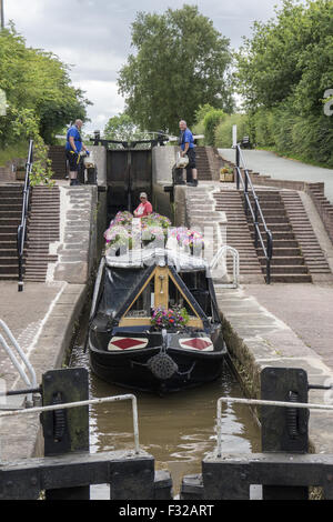 Canal or narrow boat on the Llangollen branch of the Shropshire Union Canal passes through the village of Grindley - Stock Photo