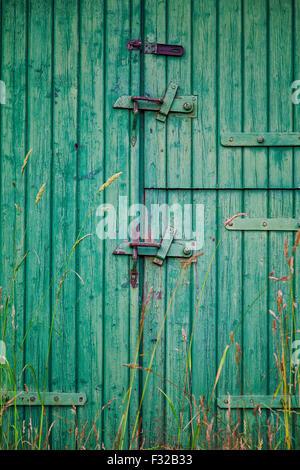 Image of a worn old barn door. - Stock Photo