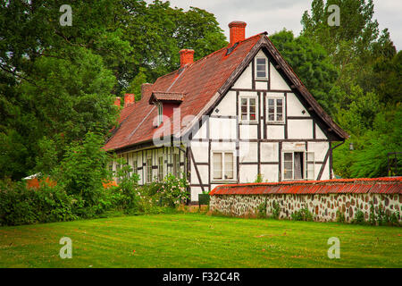 Image of an old timber-frame building, European style. Ortofta, Sweden. - Stock Photo
