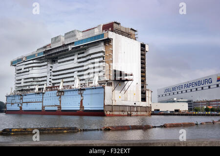Part of a luxury passenger ship under construction on the Meyer Werft in Papenburg - Stock Photo