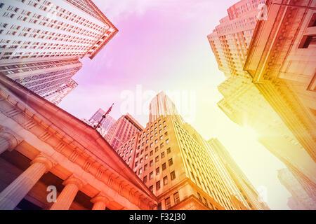 Vintage instagram filtered Wall Street at sunset, Manhattan, New York City, USA. - Stock Photo