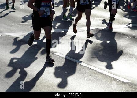 Berlin, Germany. 27th Sep, 2015. Runners' shadows during hte 42nd Berlin Marathon in Berlin, Germany, 27 September - Stock Photo