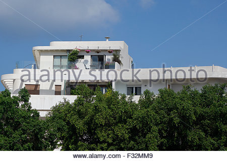 An old building in Bauhaus architecture style in Dizengof Square downtown Tel Aviv Israel. Tel Aviv is a UNESCO - Stock Photo