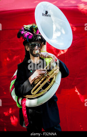 Beorma Border Morris dancer in costume with his sousaphone - Stock Photo