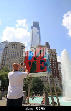 The bright red LOVE sculpture by Robert Indiana in Love Park, in Philadelphia, Pennsylvania, USA - Stock Photo