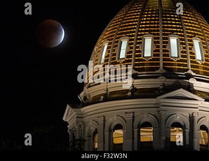 A perigee full moon, or supermoon, rises behind the Colorado State Capitol Building during a total lunar eclipse - Stock Photo