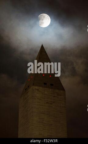 A perigee full moon, or supermoon, rises behind the Washington Monument during a total lunar eclipse September 27, - Stock Photo