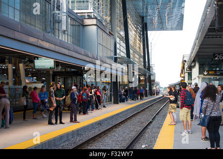 Commuters on the platform at Union Station in Toronto waiting for the GO train - Stock Photo