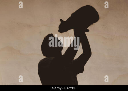 old photo boy with a cat shadows - Stock Photo