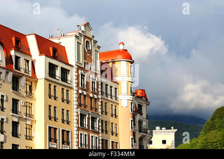Facade of a massive building with turret, galleries and balconies - Stock Photo