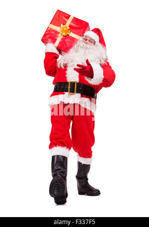 walking Santa Claus carries Christmas gift isolated on white background - Stock Photo
