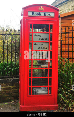 Red telephone box now used as a book exchange. - Stock Photo