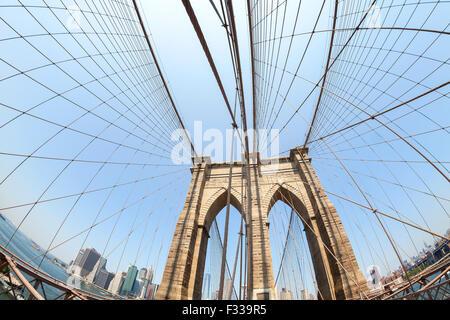 Brooklyn Bridge in fisheye lens, NYC, USA. - Stock Photo
