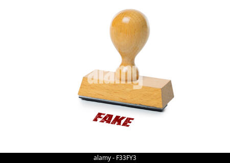 Fake printed in red ink with wooden Rubber stamp isolated on white background - Stock Photo
