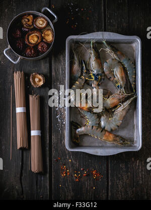 Uncooked Soba noodles and shrimps - Stock Photo