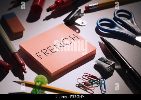 French against students table with school supplies - Stock Photo
