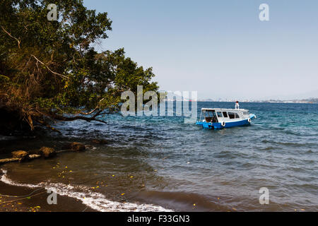 Dive boat in the water at Lembeh Strait, North Sulawesi, Indonesia - Stock Photo