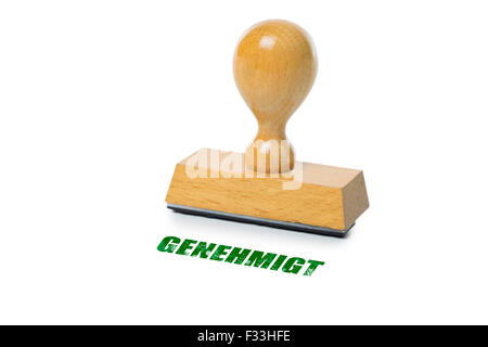Genehmigt (German Approved) printed in red ink with wooden Rubber stamp isolated on white background - Stock Photo