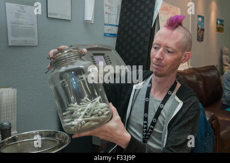 Individual marijuana joint is most popular item in marijuana dispensary.  Denver, CO - Stock Photo