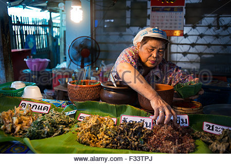 Woman seller, Food stall, Fish, vegetables, fast food, Ko Kret (also Koh Kred) is an island in the Chao Phraya River, - Stock Photo