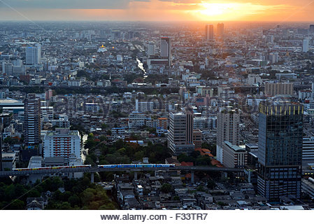 Sunset Landscape from Red Sky Restaurant Rooftop, Bangkok, Thailand, On the top floor of the Centara Grand skyscraper - Stock Photo
