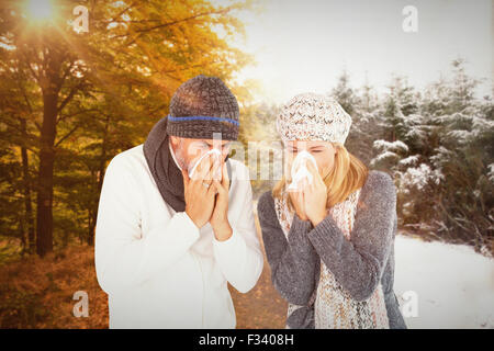 Composite image of couple sneezing in tissue - Stock Photo