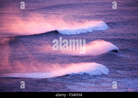 waves breaking on the beach looking west from Dyrhólaey at dusk, Iceland - Stock Photo