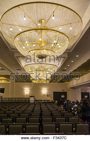 Conference hall with big chandeliers and several rows of vacant conference hall with big chandeliers and several rows of vacant chairs there is a dais aloadofball Image collections